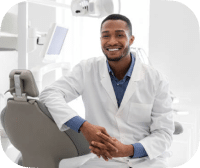 Male Doctor Smiling In Office