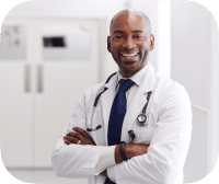 Smiling Male Doctor With Stethoscope Over Shoulders